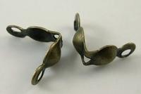 Kalotje met dubbel oogje ijzer brons